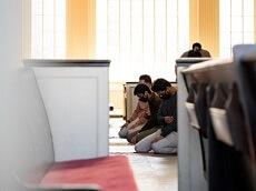Students Praying at Hendrick Chapel