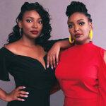 Photo of JaNeika and JaSheika James wearing a black and red dress.