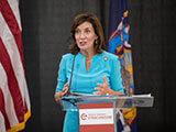 Governor Kathy Hochul speaking behind podium