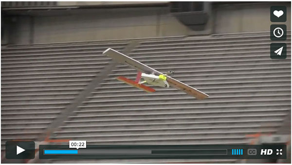 Model plane flying in Carrier Dome